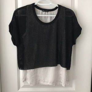 Zara top size small. Runs small. Would fit xs.